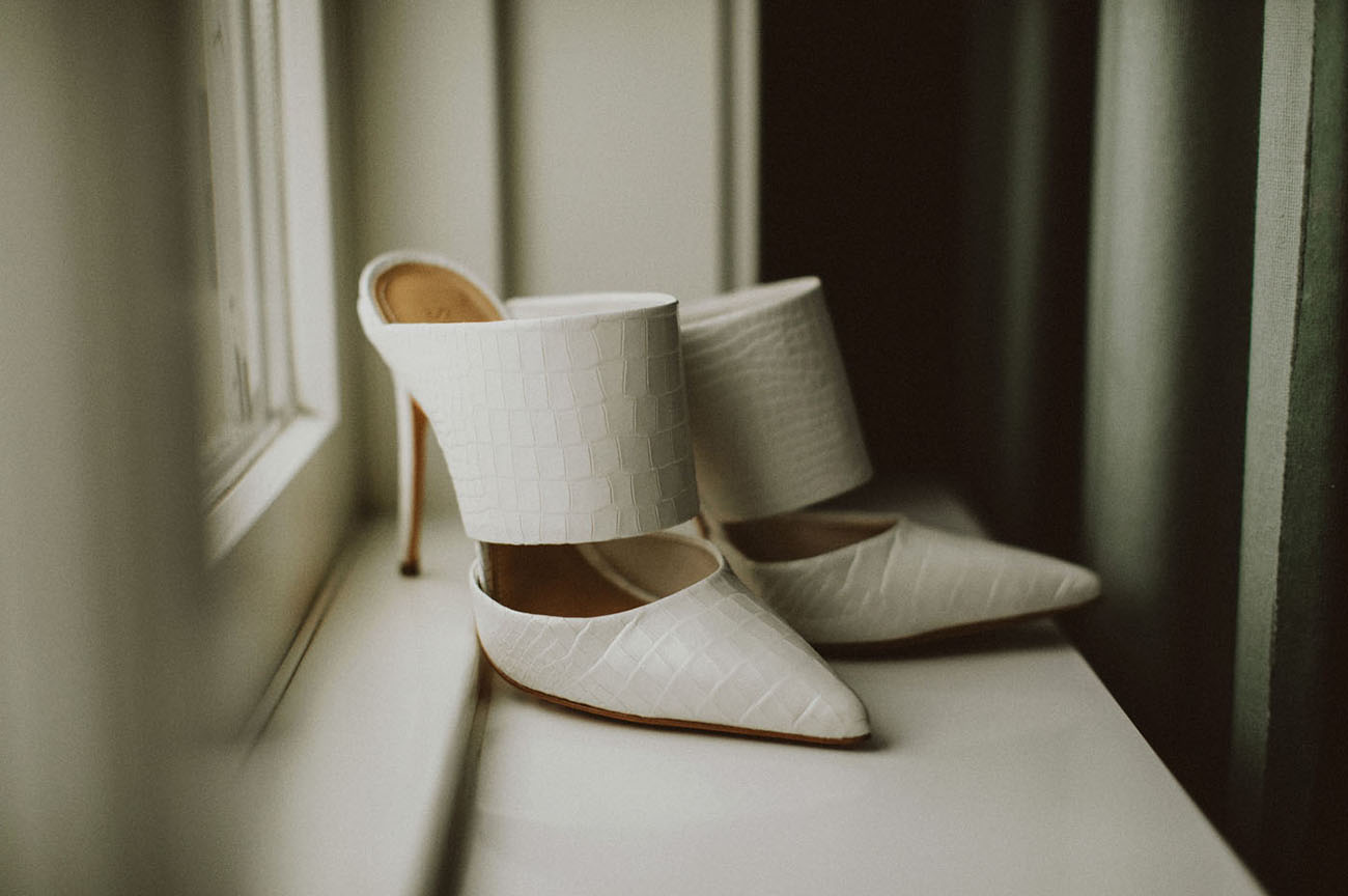 Here are her unique and bold shoes of white leather