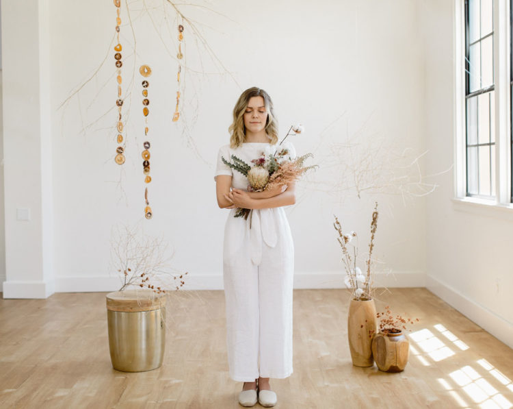 The bride was first wearing a handmade white linen suit and flats for a minimalist feel