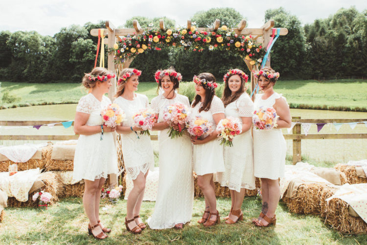 The bridesmaids were rocking knee and midi white lace dresses with short sleeves and brown shoes