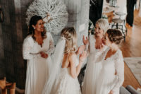 04 The bridesmaids were wearign all-white wedding dresses with lace sleeves and bodices