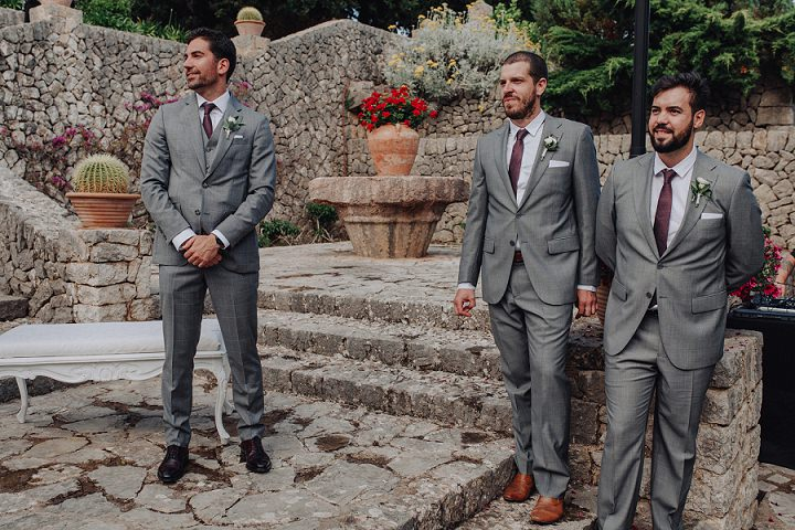 The groom and groomsmen were rocking grey suits and burgundy ties