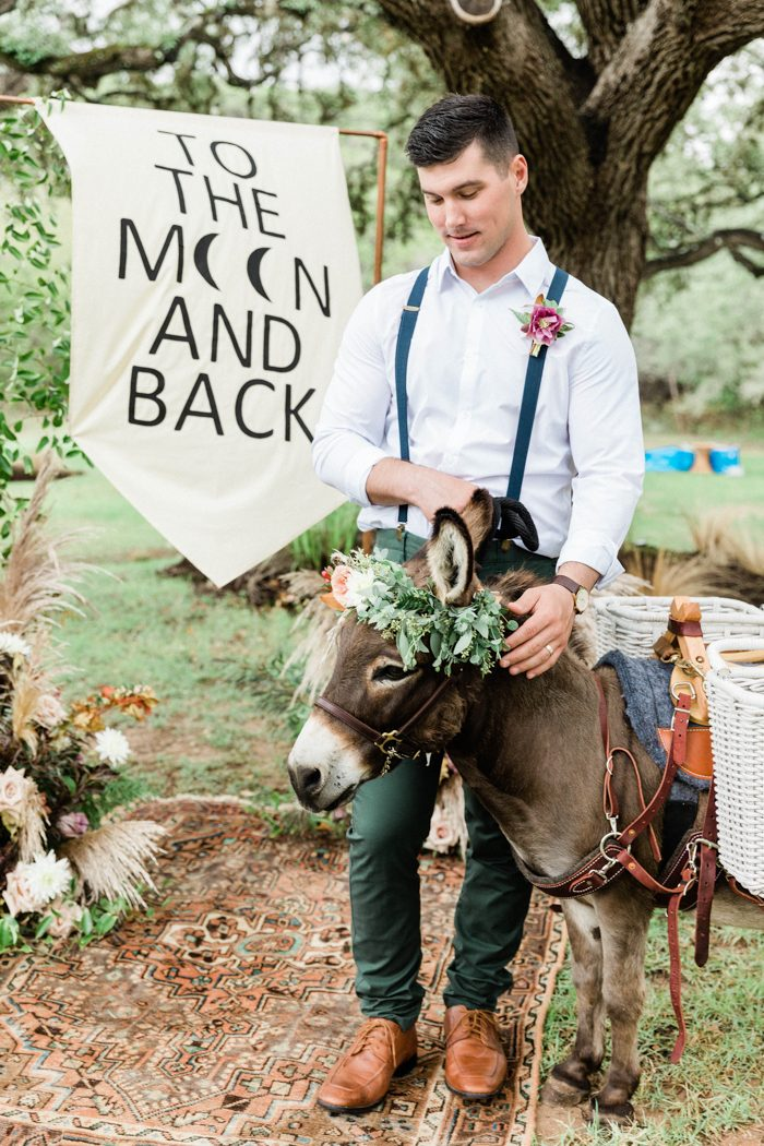 The groom was wearing a relaxed boho look with green pants and suspenders, brown shoes and a white shirt