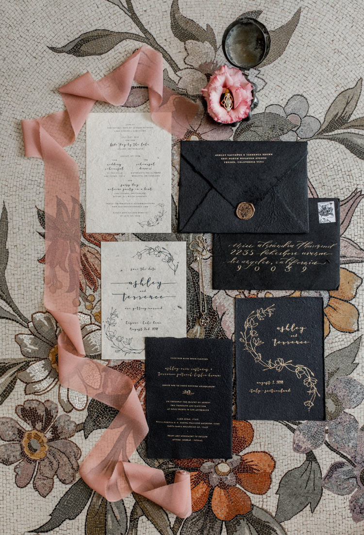 The wedding stationery suite was refined, in black and off-white with gold calligraphy