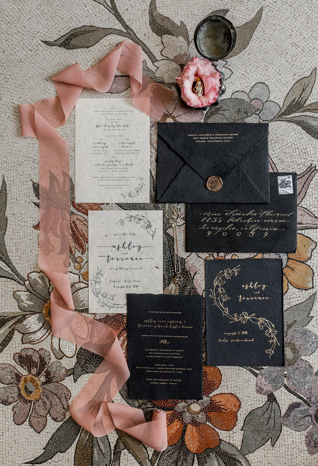 The wedding stationery suite was refined, in black and off white with gold calligraphy