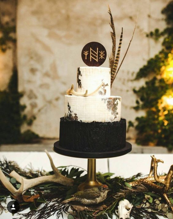 a dark stained wooden slice cake topper with runes is awesome for a boho chic wedding in fall or winter