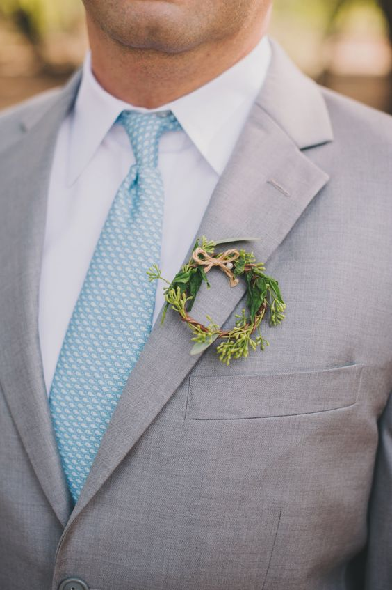 a little greenery wreath boutonniere with a small twine bow is right what you need to refresh the outfit
