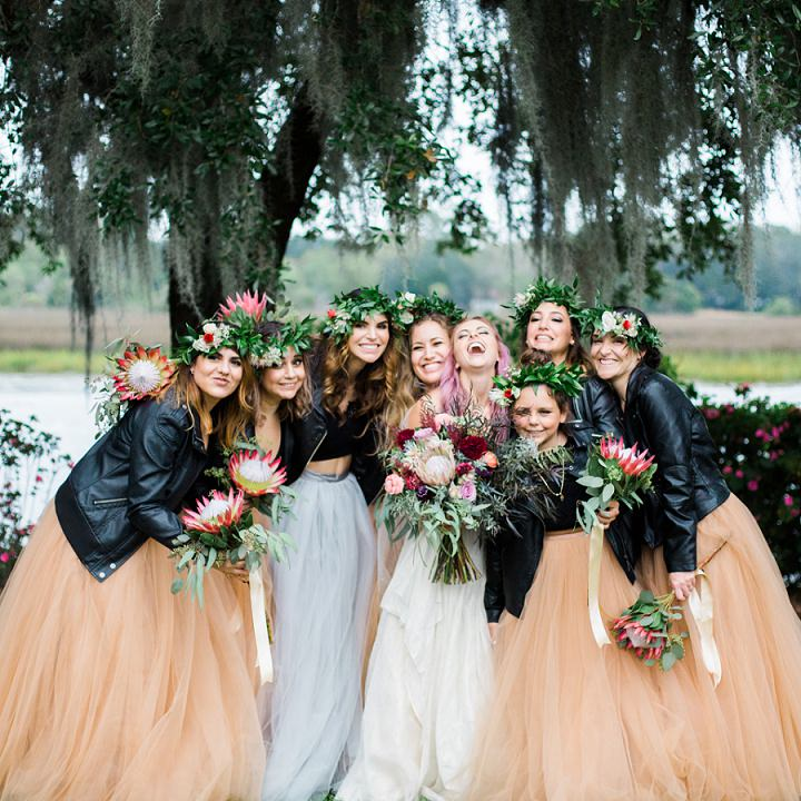 The bridesmaids were wearing mismatching black tops, rust tulle skirts and black leather jackets