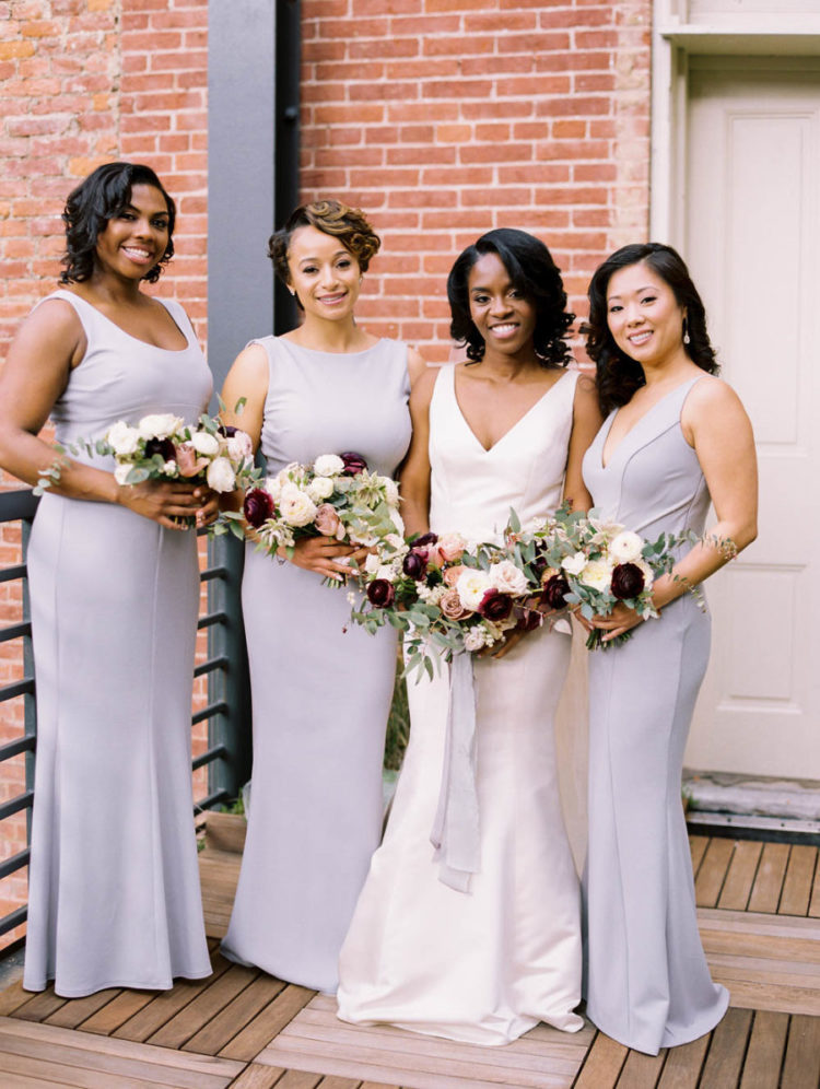 The bridesmaids were wearing off-white maxi gowns