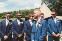05 The groom and his best man were wearing three-piece blue suits and the groomsmen were wearing navy