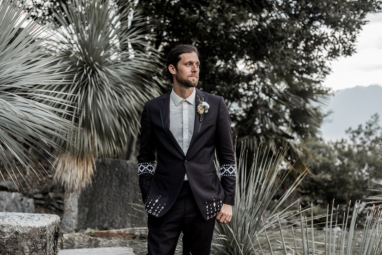The groom designed his own deep purple tuxedo with embroidery for the wedding