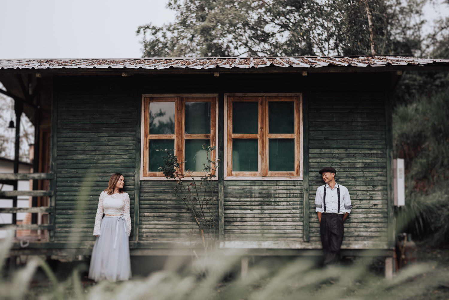 The guys were also wearing more casual looks, a lace crop top and a grey skirt for the bride and suspenders with pants for the groom