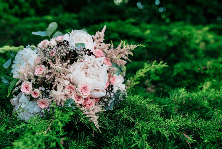 The wedding bouquet was done in whites and pink shades, with herbs and foliage