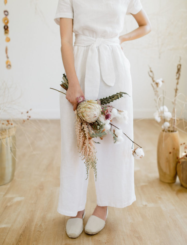 The wedding bouquet was textural and dimensional, with cotton, dried herbs, greneery and leaves