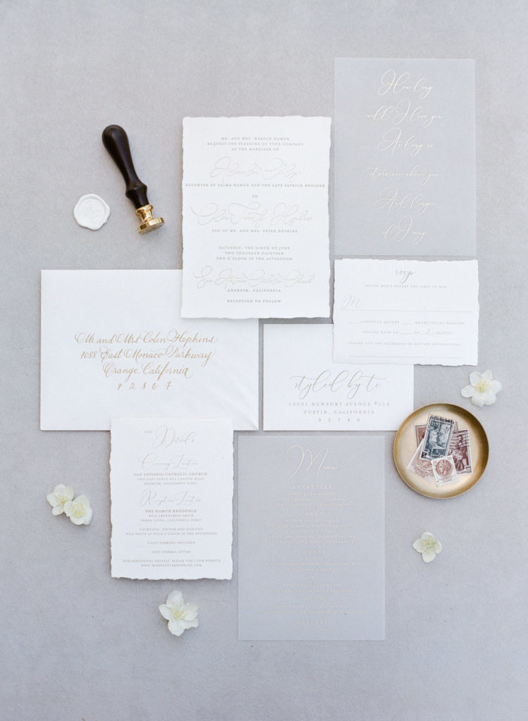 The wedding stationery suite was an elegant one, with acrylic and white parts and a raw hem