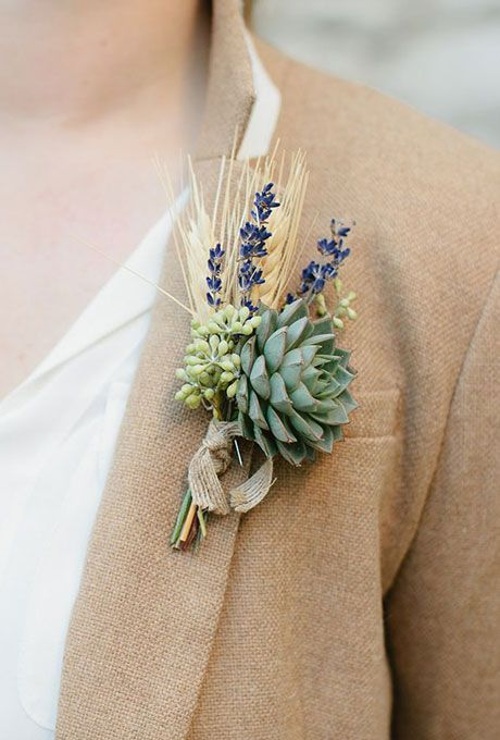 a boutonniere with wheat, lavender, berries and a succulent plus a burlap ribbon wrap