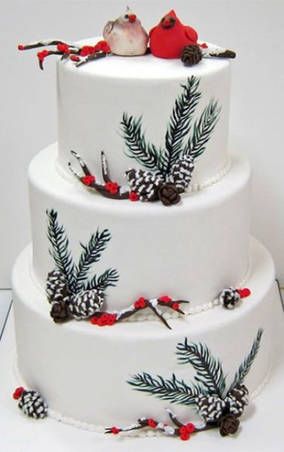 a duo of birds made of pastry is a cool and chic idea for a winter-themed wedding cake, a couple of lovebirds