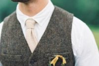 05 a small wreath groom boutonniere with greenery and a yellow ribbon spruces up a vintage groom's look making it bolder