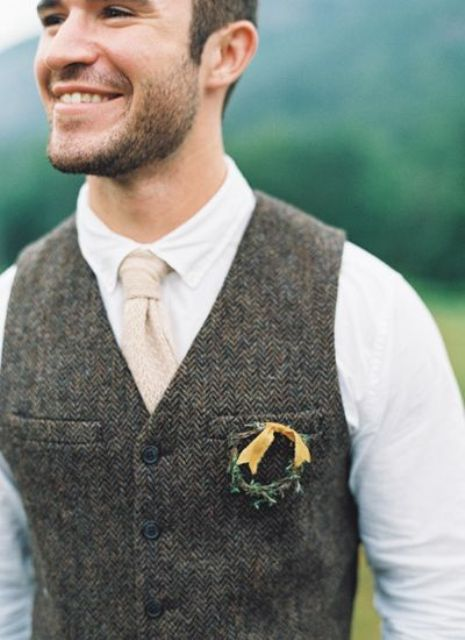 a small wreath groom boutonniere with greenery and a yellow ribbon spruces up a vintage groom's look making it bolder