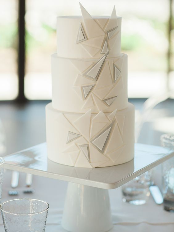 a white geometric wedding cake with grey triangles and a 3D effect for a modern or minimalist wedding