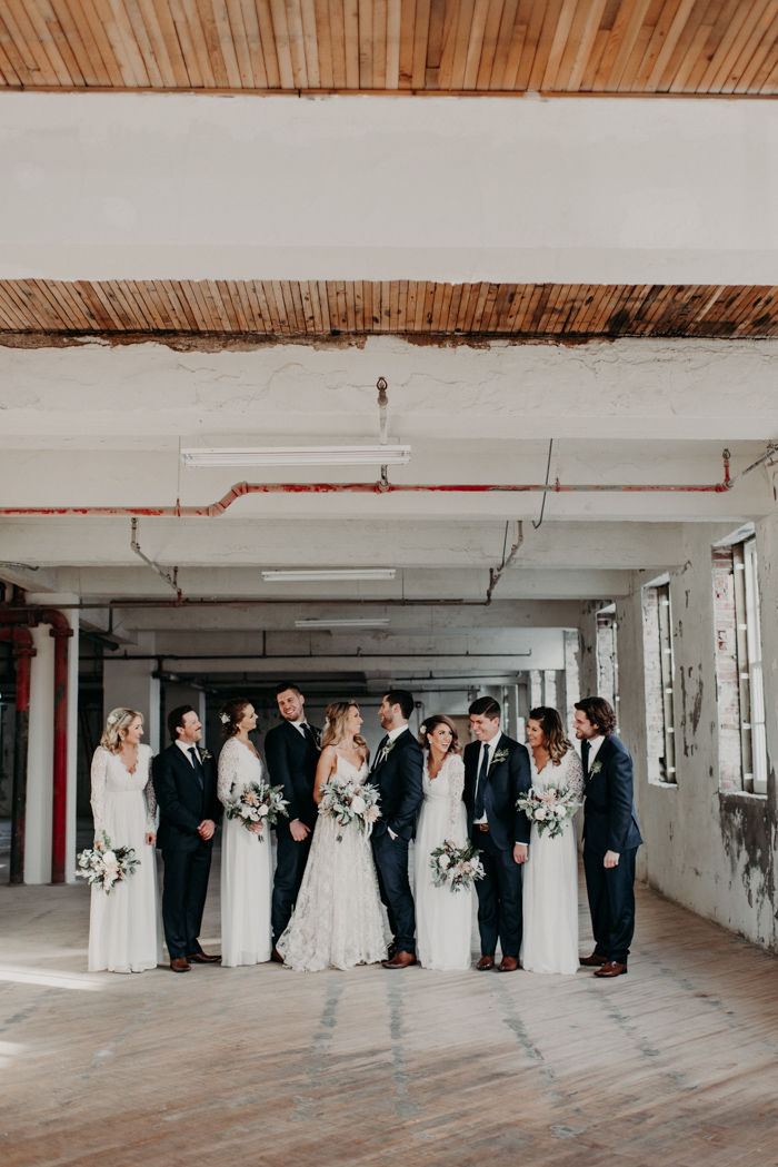 The groomsmen were wearign navy suits with brown shoes