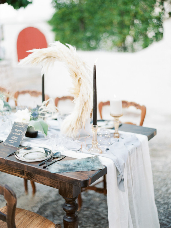 The wedding tablescape also features the moon of pampas grass and stars of copper wire