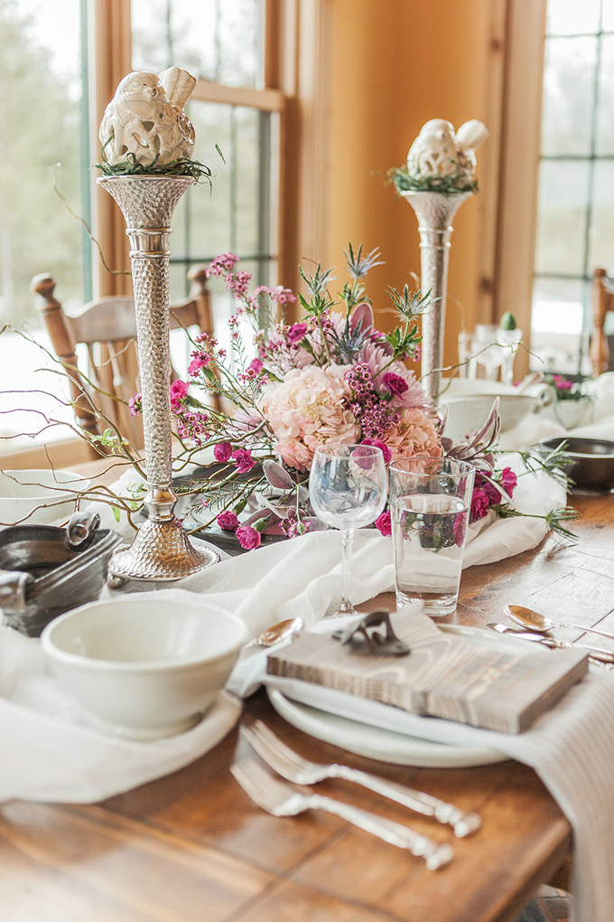 The wedding tablescape was done with rustic and heirloom touches, silverware was heirloom and plates were handmade ones