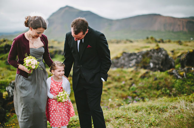 a bridal outfit with a grey strapless dress and a burgundy cardigan to stay warm at an outdoor ceremony