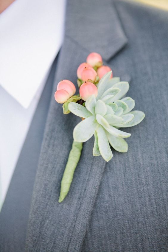 a cute groom's boutonniere of a succulent and hypericum berries plus floral wrap