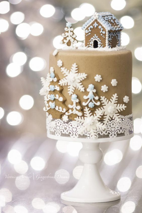a gingerbread house and a little tree are a great idea to embrace the season and make your wedding feel like holidays