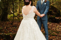 07 The groom was wearing a three-piece blue suit with a colorful boutonniere