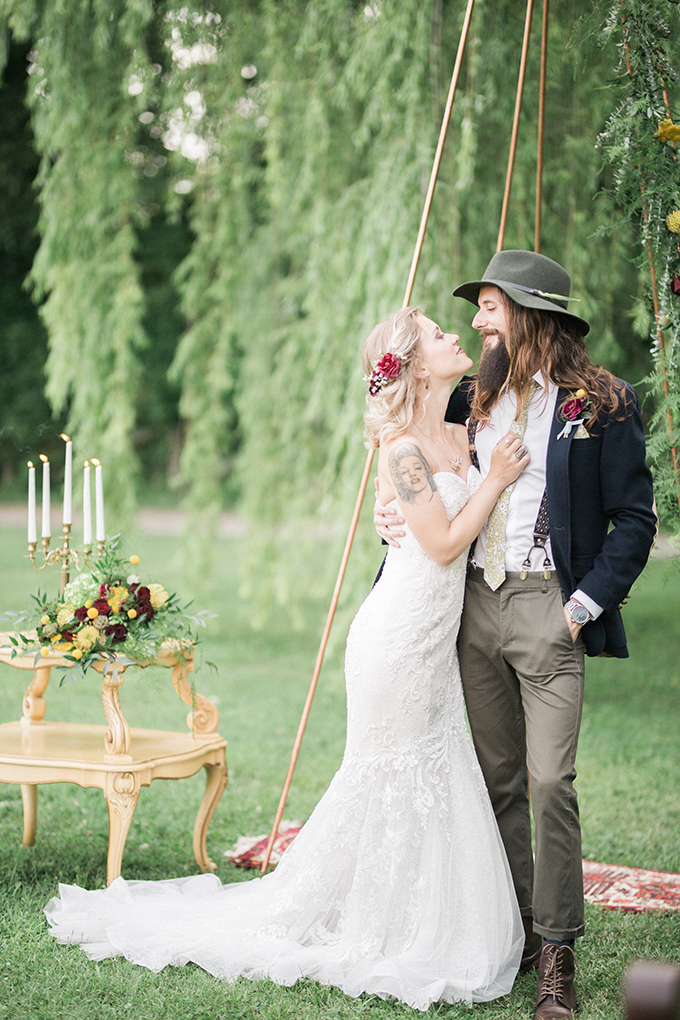 The groom was wearing a whimsy outfit with vintage and boho chic touches, and the bride was rocking a strapless lace mermaid gown