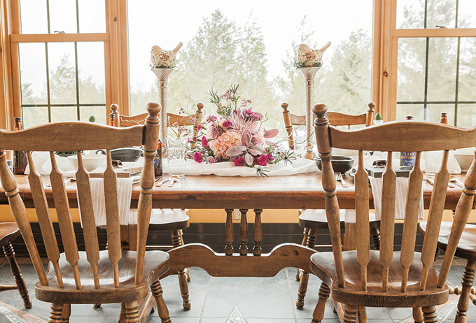 The table was laid in a lodge, with amazing views and vintage wooden furniture