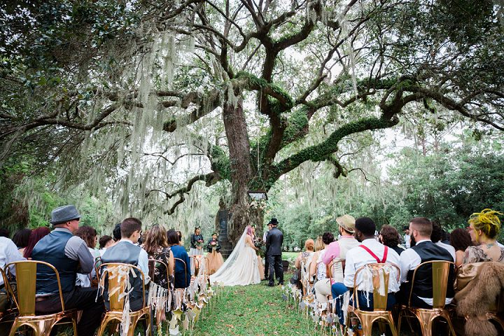 The wedding altar was a living tree and there was a floral chandelier hanging from above