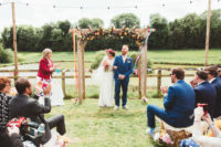 07 The wedding arch was done with bright florals, pink and yellow ones