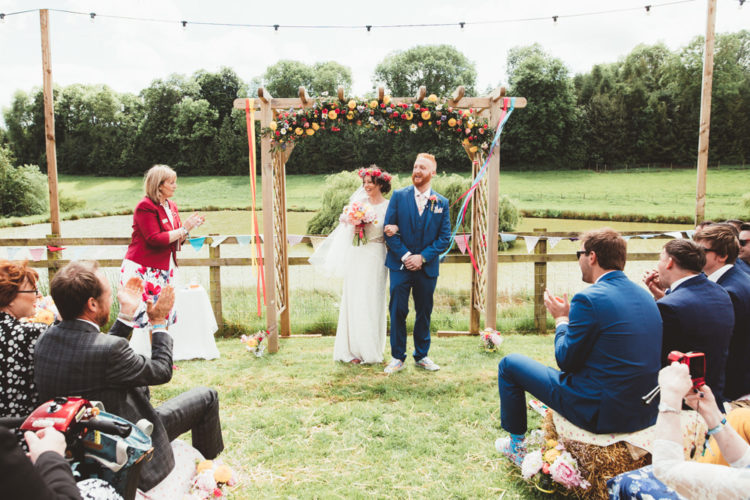 The wedding arch was done with bright florals, pink and yellow ones