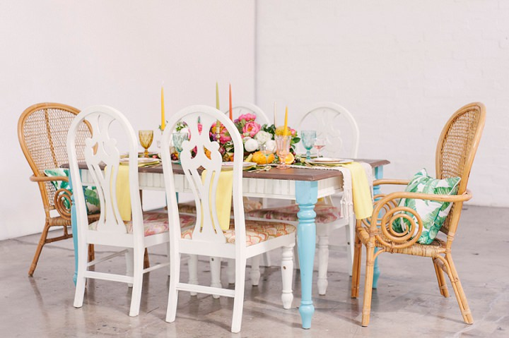 The wedding table was styled with bright shades, florals and fruits plus a colorful runner