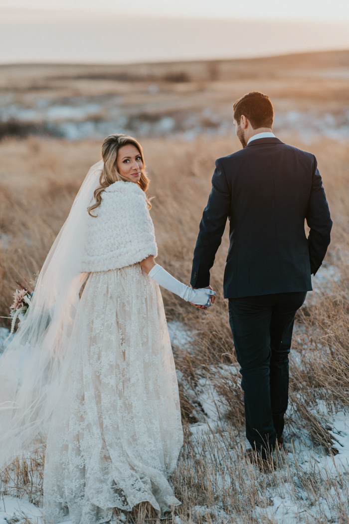 For outdoor shots, the bride was rocking a white coverup and long gloves