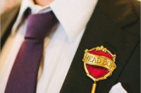 08 Harry Potter boutonniere idea for a groom or a groomsman adds color and adds a nerdy feel to the outfit