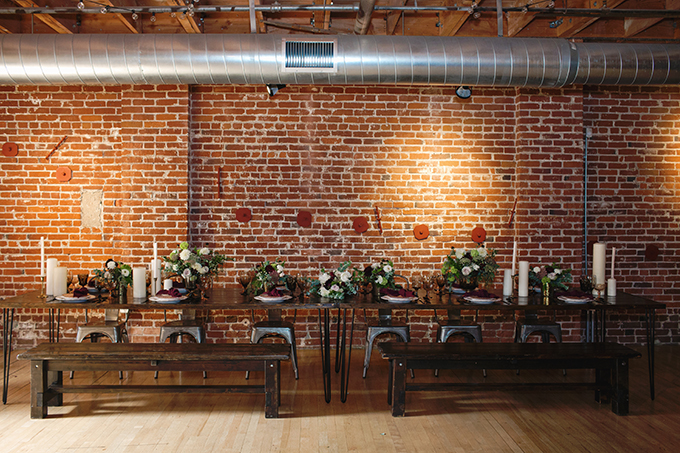 The industrial venue was softened with lush florals and gorgeous candles that created a welcoming ambience