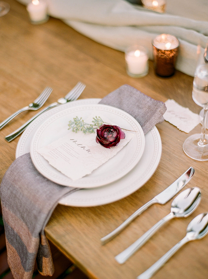 The place settings were done with elegant cutlery, plates and neutral napkins plus bright blooms