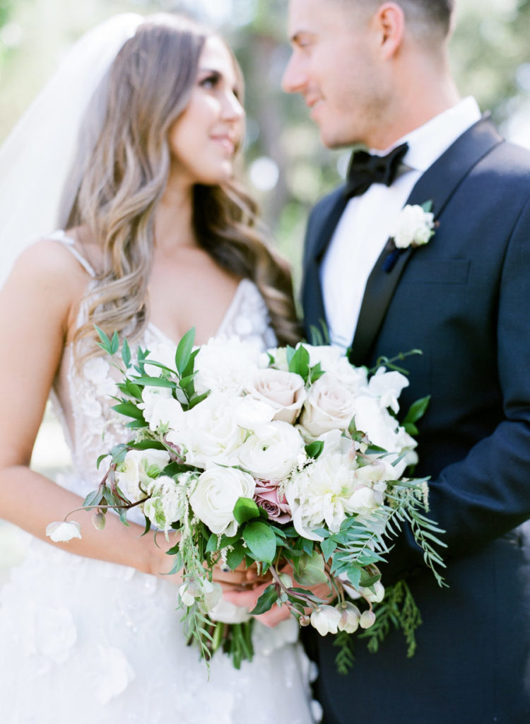 The wedding bouquet was super elegant, with white and dusty pink roses and foliage