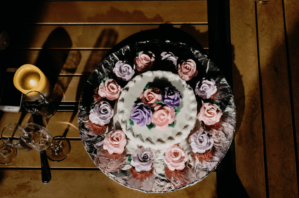 The wedding cake was a buttercream one with colorful cream flowers and there were matching cupcakes served