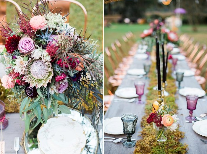 The wedding tablescape was done with a moss runner, black candles, bright blooms and colorful glasses