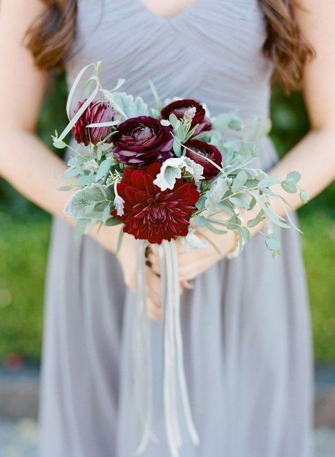 a grey bridesmaid dress plus a cool bouquet of pale greenery and burgundy blooms is a contrasting idea