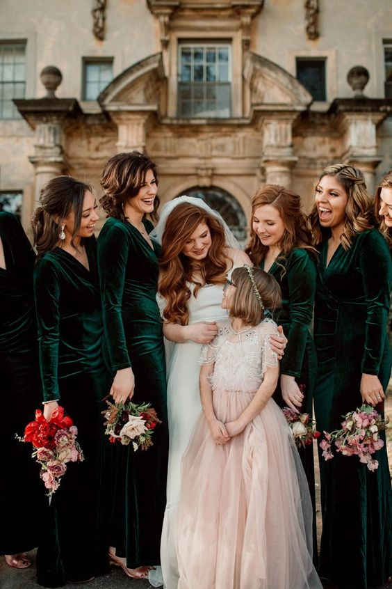 long sleeve velvet dresses will keep your girls warm during the whole wedding and maybe they won't require coverups