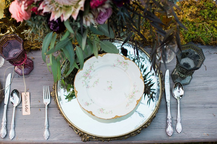 Elegant mirror chargers, floral plates and vintage cutlery made the table setting more chic