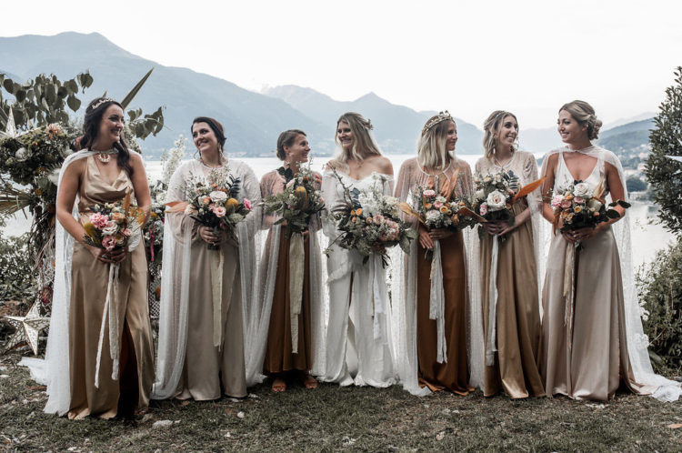 The bridesmaids were rocking pastel and muted silk gowns with sheer pearled capes