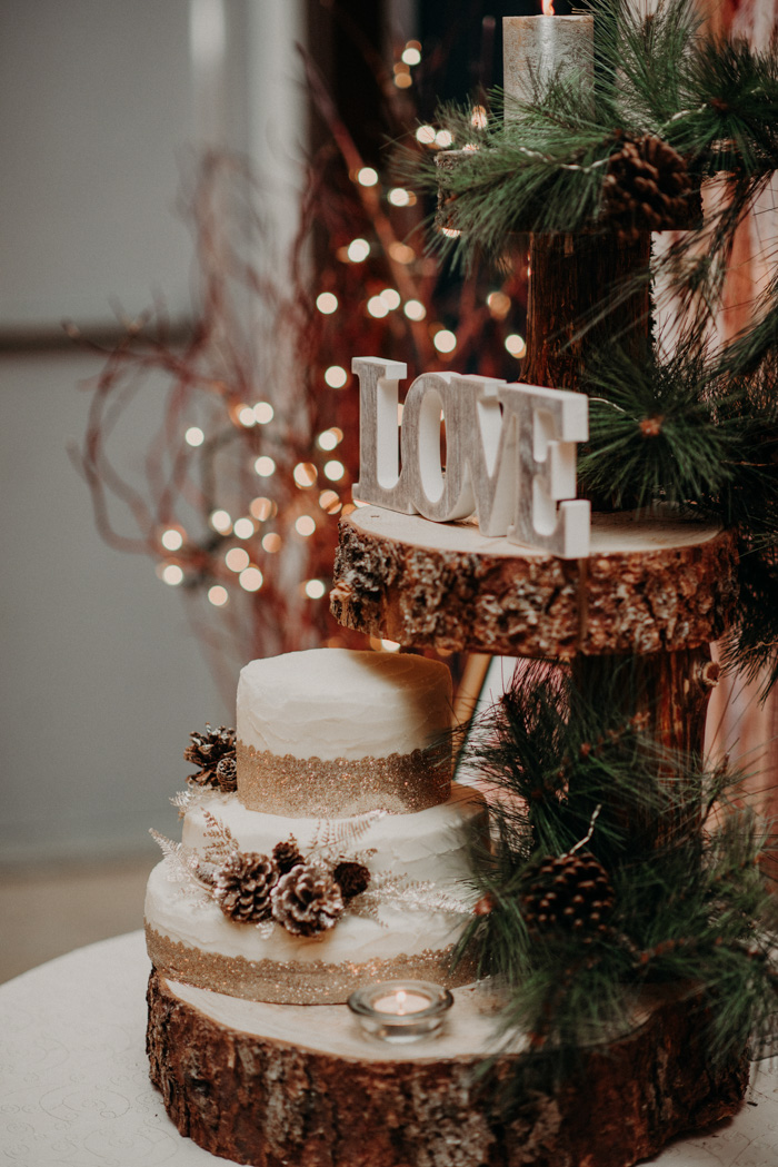 The wedding cake was a buttercream one with edible glitter and pinecones