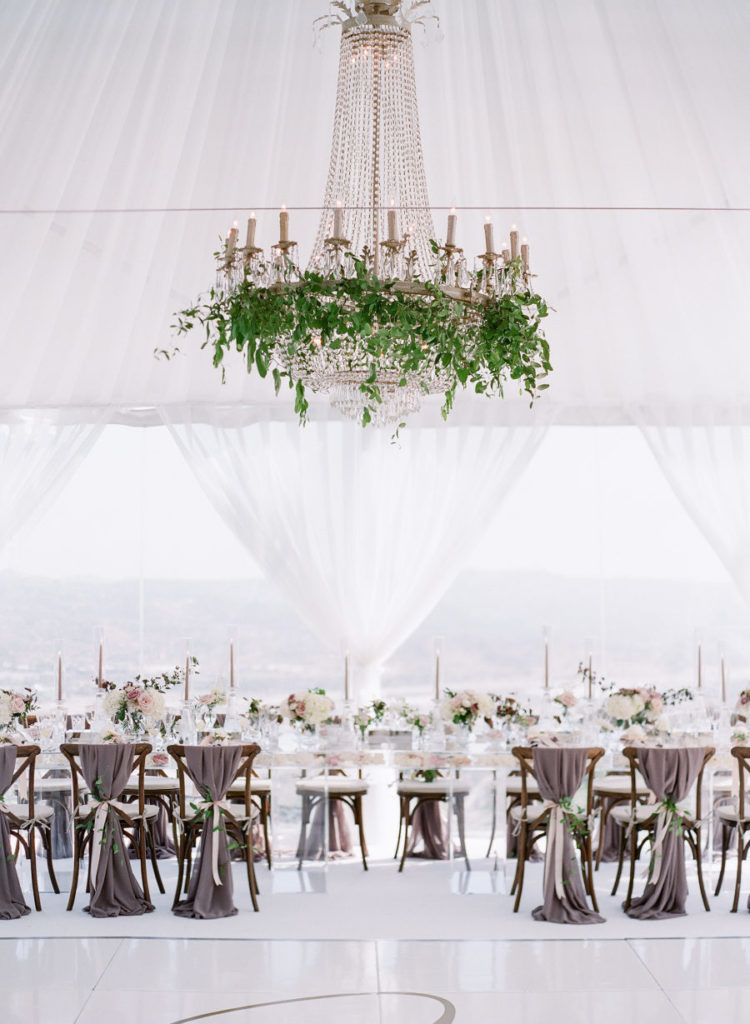 The wedding venue was super elegant and refined, done with lush greenery and blooms for a garden feel