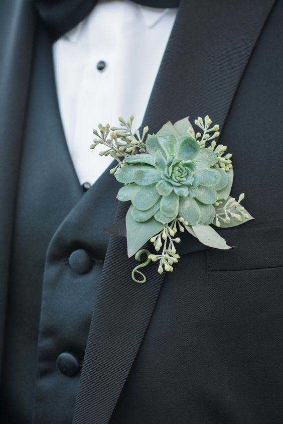 a large succulent boutonniere with seeds from eucalyptus for an elegant modern feel